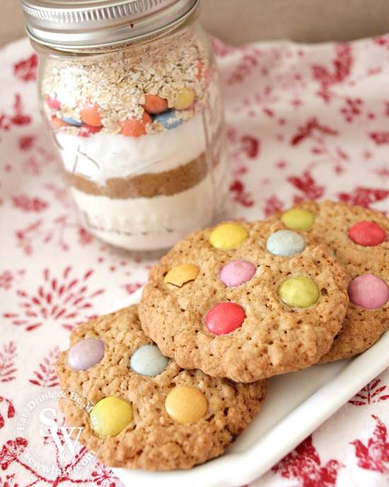 cookie mix jar next to the finished cookies on a white plate