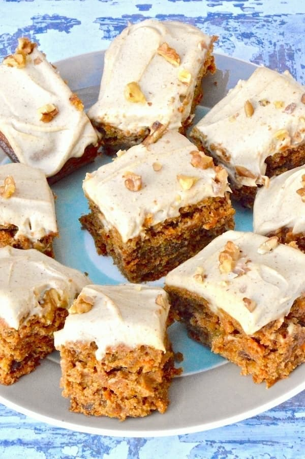 Vegan carrot cake with cashew icing from Tin and Thyme decorated with chopped nuts
