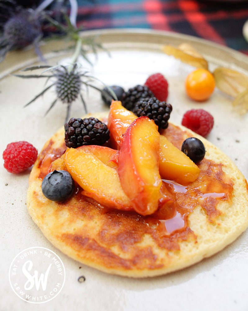 Scotch Pancake with peach compote and fresh berries