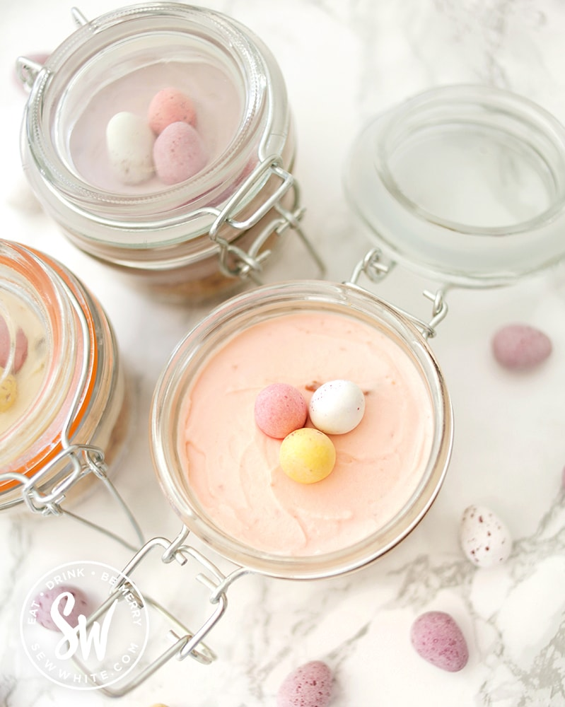 open clip lock jar with mini cheesecakes for easter with mini eggs
