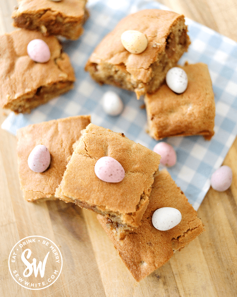 mini egg cookie traybake for easter. Chocolate easter eggs in a chunky cookie