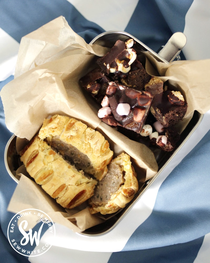 best picnic accessories - wakecup metal lunchbox with divider and sausage roll and rocky road