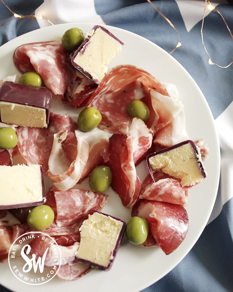 charcuterie on a white plate in the nobel house picnic range