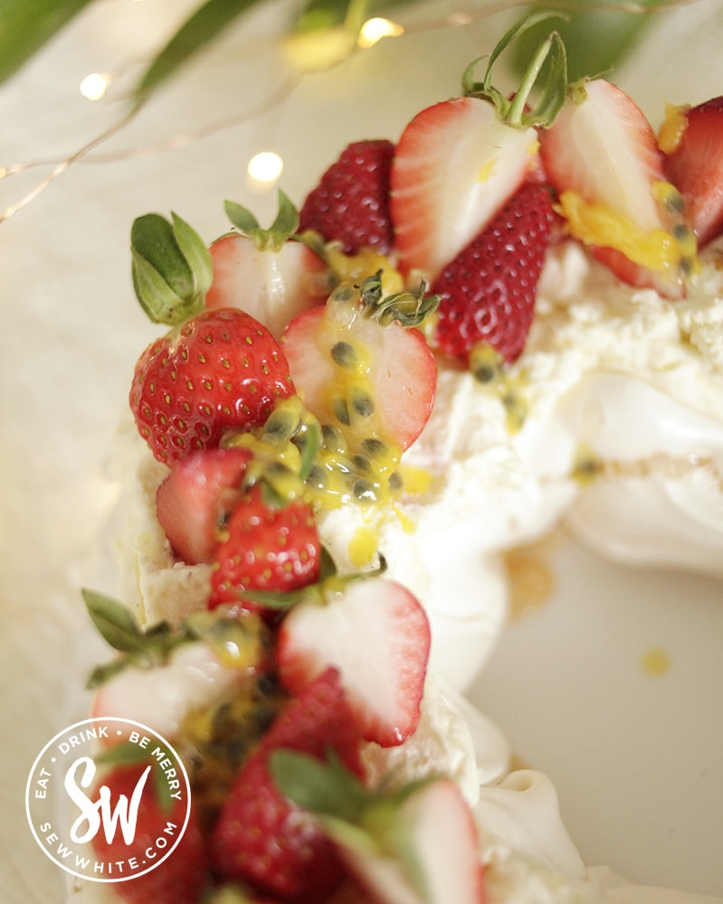 Strawberries with fresh Passionfruit drizzled over a cream Pavlova - Strawberry Passionfruit Pavlova