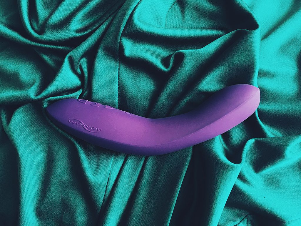 photo of purple we-vibe rave on its side on green cloth