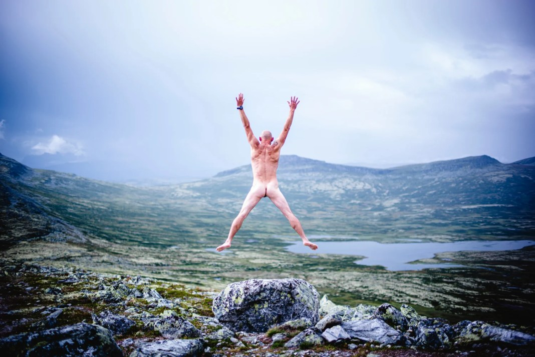 nude ecosexual man jumping