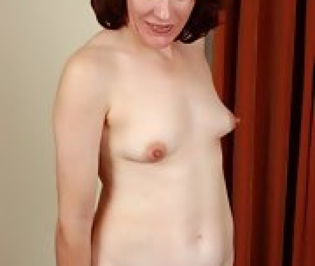 Redhead Mature Woman Exposes Her Large Pussy Lips