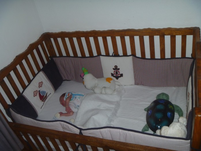 Big boy bed.  I still see this tiny boy