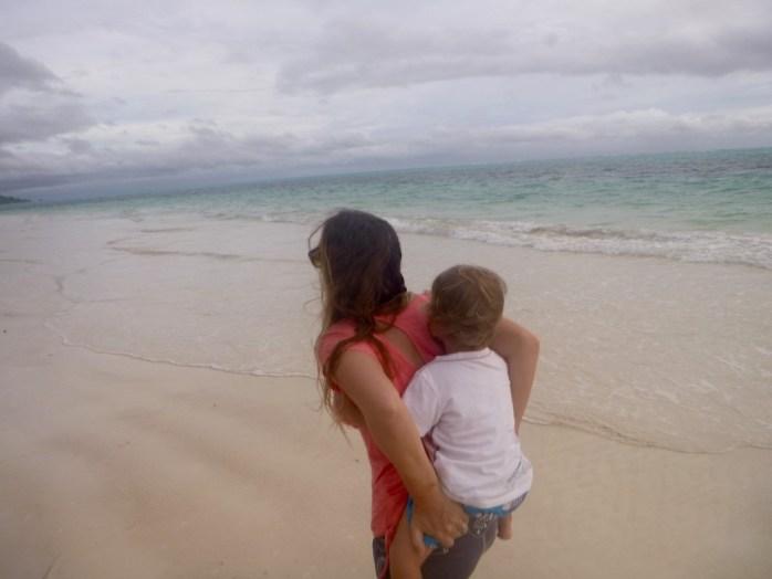 Family walk on the beach. Piggy back. Praslin Seychelles