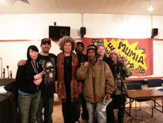 After this Block Report interview at KPFA, the apprentices and other staff who had conducted and assisted with the recording gathered around the legendary Angela Davis for this portrait: from left, Angie D, Frank Sterling, Angela Davis, filmmaker Semaj, Minister of Information JR, Noelle Hanrahan and Mikki Mayes aka Ms. M. – Photo: Adalia