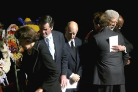 Dellums' reaction when a young Black man kills white cops: The March 27 funeral for the four Oakland cops killed by Lovelle Mixon was an apparent love fest – here Gov. Arnold Schwarzenegger hugs Oakland Mayor Ron Dellums. However, at the request of at least one of the slain officers' families, neither Dellums nor Congresswoman Barbara Lee spoke. – Photo: Pool/Getty Images