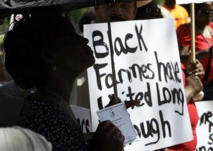 """At their rally April 28, Rep. Artur Davis reassured National Black Farmers Association that Congress and the Obama administration will deliver on a promise to compensate them for past discrimination by the Department of Agriculture. """"I know the heart of the president,"""" said Davis. """"I think you're going to like what's going to happen."""" The farmer's sign says, """"Black farmers have waited long enough."""" Photo: Alex Brandon, Montgomery Advertiser"""