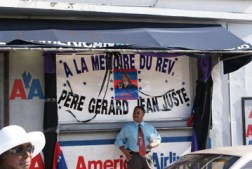 """On the funeral walk on 54th Street in Miami's Little Haiti, mourners passed many businesses signaling their solidarity and love for Father Jean-Juste, this sign reading, """"In Memory of Father Gerard Jean Juste."""" – Photo: Norluck Dorange"""