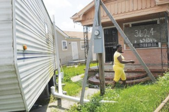 Belinda Jenkins didn't know where she'd go if FEMA repossessed her trailer. Now she can buy it for $5 while she continues to rebuild her gutted home. Progress is slow because, almost four years after Katrina, her applications for funds still have not been approved. – Photo: Cheryl Gerber, LA Times