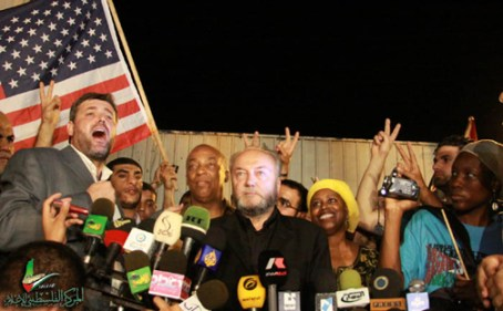 Jubilant at finally breaking the blockade to bring aid to the people of Gaza, New York City Councilman Charles Barron, Viva Palestina convoy organizer British Member of Parliament George Galloway, former Congresswoman Cynthia McKinney and M-1 of dead prez are interviewed by the press in Gaza. – Photo: Viva Palestina