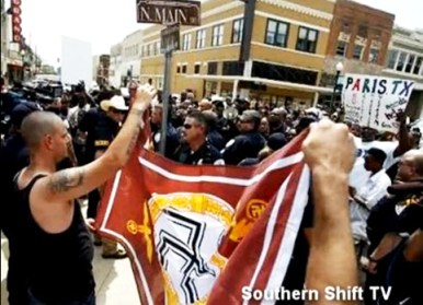 White supremacists – KKK, Neo-Nazis, skinheads – crash a Black community rally in Paris, Texas, supported by the New Black Panther Party, protesting the dismissal of charges against two white men accused of the September dragging murder of a Black man. – Photo: Jesse Muhammad
