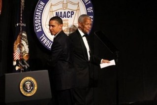 At the NAACP convention July 16, President Obama steps to the podium after being introduced by NAACP Chairman Julian Bond. – Photo: Spencer Platt, AFP/Getty Images