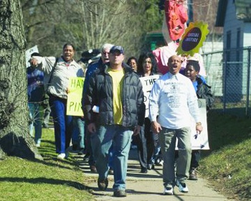 In his incessant quest for justice, Rev. Edward Pinkney heads up one of the many marches he led before his arrest.