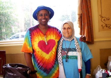 """Days after her release from an Israeli prison, Cynthia McKinney joined British Member of Parliament George Galloway and his aid convoy Viva Palestina attempting to break the blockade into Gaza through Egypt. Surmounting interminable obstacles, Cynthia wrote on July 15, """"I made it to Gaza!"""" The fact that among over 200 people in the delegation, the only three beside Galloway who are well known - McKinney, NY City Councilman Charles Barron and M-1 of dead prez - are Black made this triumph all the more significant. - Photo: Courtesy Cynthia McKinney"""