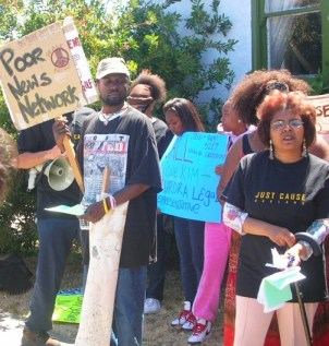 Karen Mims is surrounded by supporters as she fights the loan company that is trying to force her out of her home. – Photo: Poor News Network