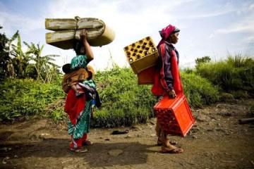 "The caption for this photo, illustrating a story headlined ""African advocates say Canada owes Congo"" on the Vancouver, Canada-based Straight-com, reads, ""Women are in constant danger in Eastern Congo, where most of the recent fighting has taken place and rape is widespread."" The story, quoting two Congolese now in Canada, attributes the violence not to tribal conflict but to ""a war of resources … a war of cellphones"" but is divided over whether Canada should intervene militarily. – Photo: Dominic Nahr, MSF"