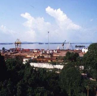 The view across the Congo River from Kinshasa to Brazzaville in this 2006 photo shows Kinshasa's transshipment port for timber exploitation and export to Europe, Asia and North America. – Photo: Keith Harmon Snow