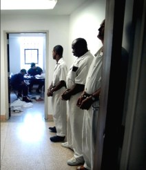 Inmates line up for the classification process at Angola. All new arrivals start out working in the cotton fields and spend years trying to work their way up to better jobs. – Photo: Paul Taggert, NPR