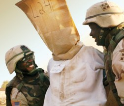 """U.S. forces, including these modern """"Buffalo Soldiers,"""" round up all the men in the village of Mashahdah, Iraq, in 2003. – Photo: Revcom.us"""