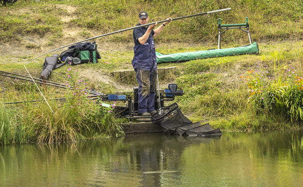 Scotland's David Corcoran plays a carp on his way to the Individual Title in the Senior event.