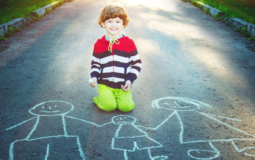 Child draws family, awaits adoption.