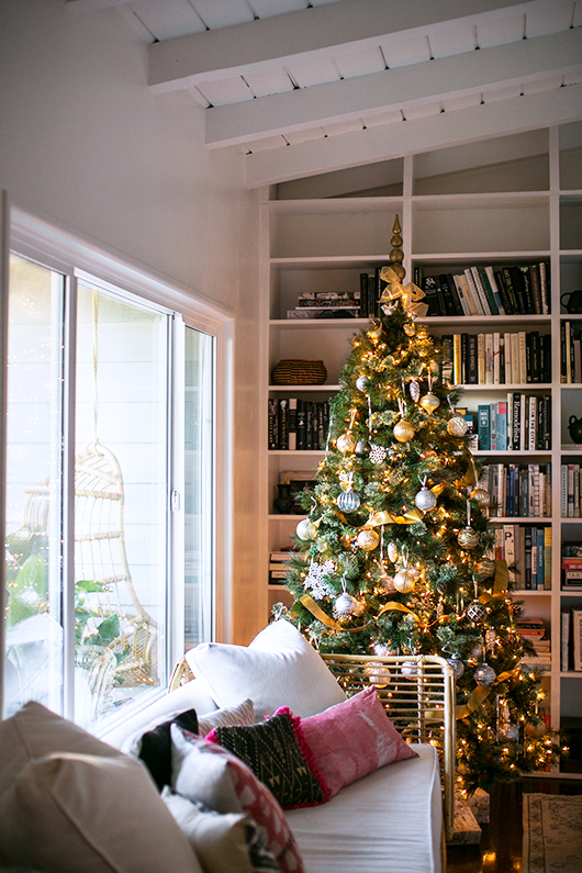 faux christmas tree decked out in gold and silver ornaments / sfgirlbybay