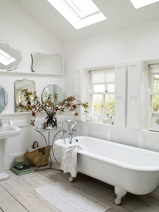 vintage mirrors on shelves in bathroom / sfgirlbybay