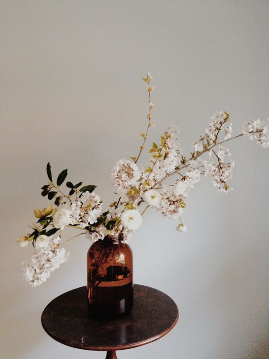 flowers in large brown glass jar / sfgirlbybay