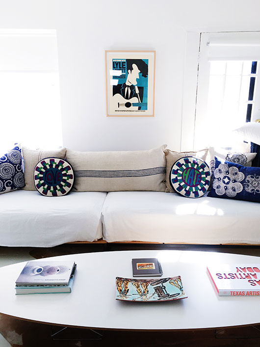 modern art and white sofa with colorful throw pillows / sfgirlbybay