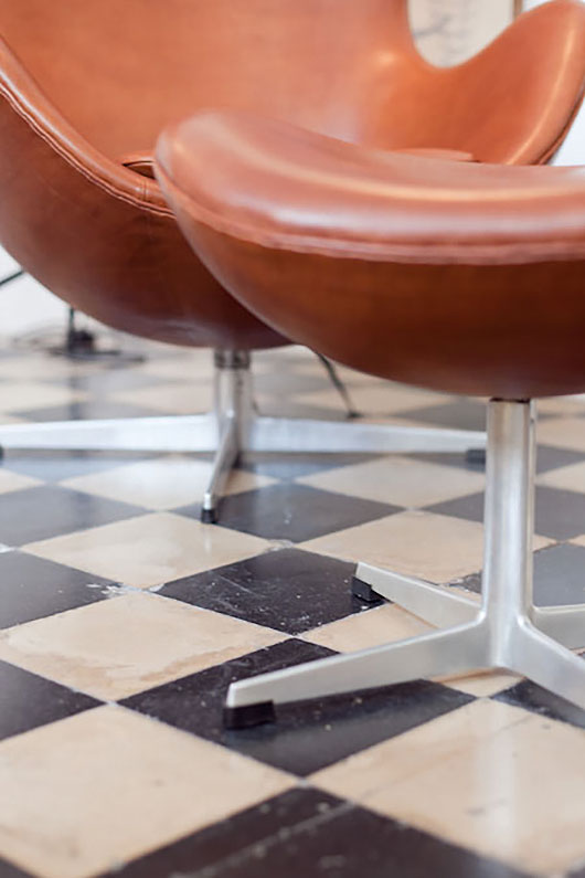 leather lounge chair and checkered flooring / sfgirlbybay