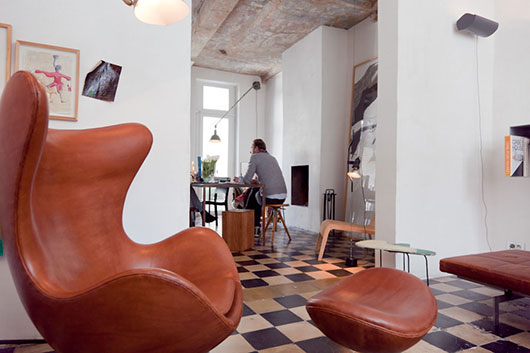 leather chair inside modern belgium home / sfgirlbybay
