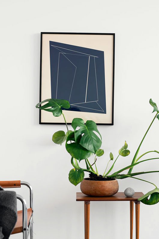 framed art print and potted plant. / sfgirlbybay