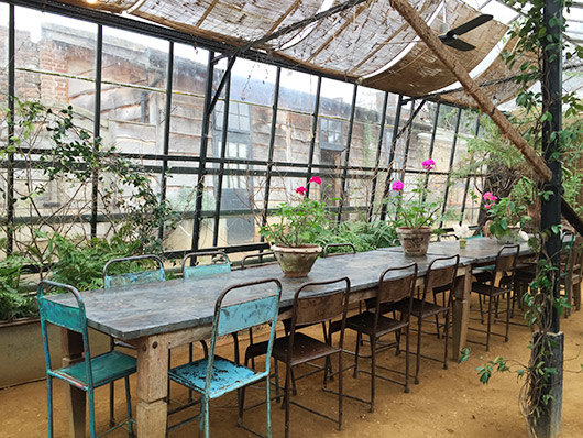 tables and chairs inside petersham nursery and garden shop. / sfgirlbybay