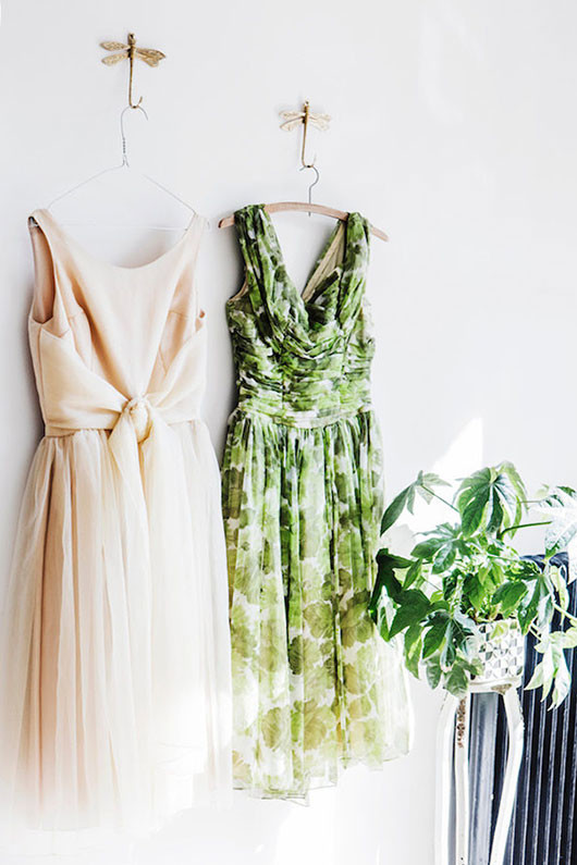 vintage dresses hung on dragonfly hooks / sfgirlbybay