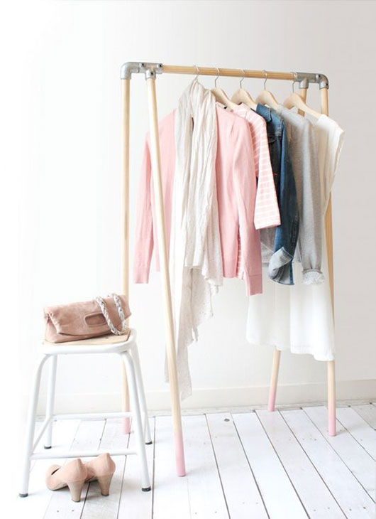 wood and metal clothing rack with pink dipped legs / @sfgirlbybay
