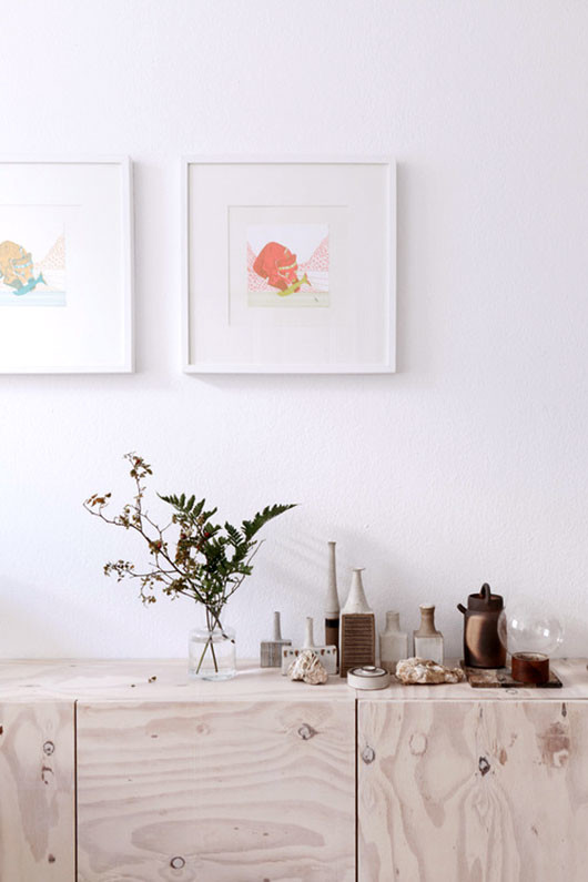 framed art prints above plywood credenza via studio oink / sfgirlbybay