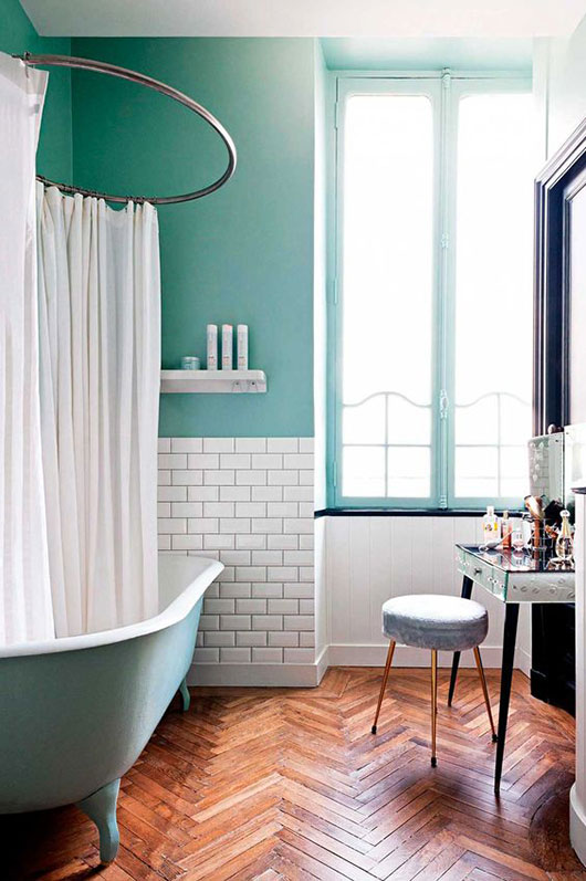 green and white bathroom with clawfoot tub in paris penthouse / sfgirlbybay
