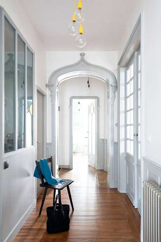 white hallway with pops of yellow and teal decor / sfgirlbybay