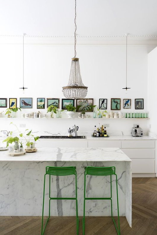 white kitchen with marble island and chandelier / sfgirlbybay