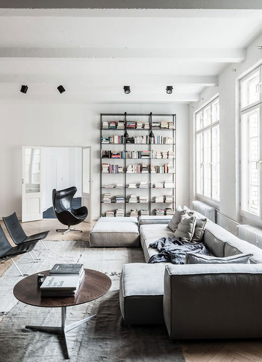 berlin loft with low gray sectional via behance. / sfgirlbybay