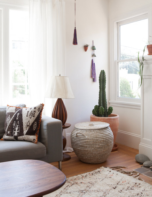 potted cacti, woven basket with white walls and modern moroccan furnishings / sfgirlbybay
