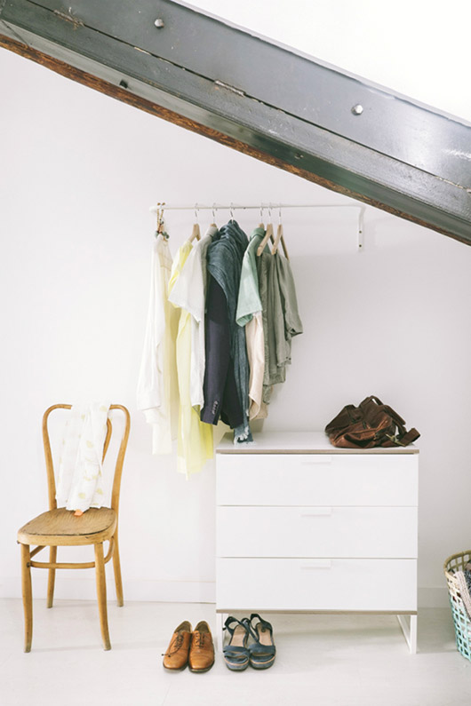 exposed closet with hanging rack, small dresser and chair / sfgirlbybay