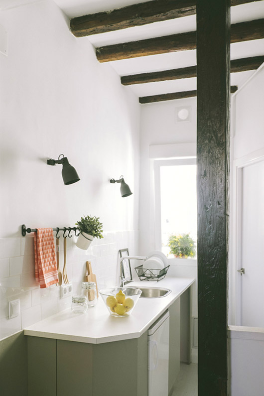 exposed dark wood beams in modern white kitchen with green cabinets / sfgirlbybay
