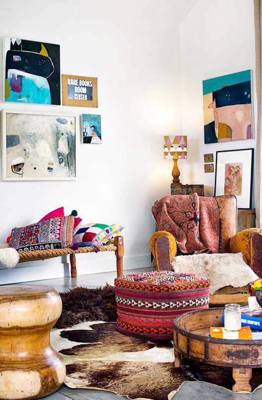 colorful vintage decor in a bohemian modern space with lots of art on the walls / sfgirlbybay