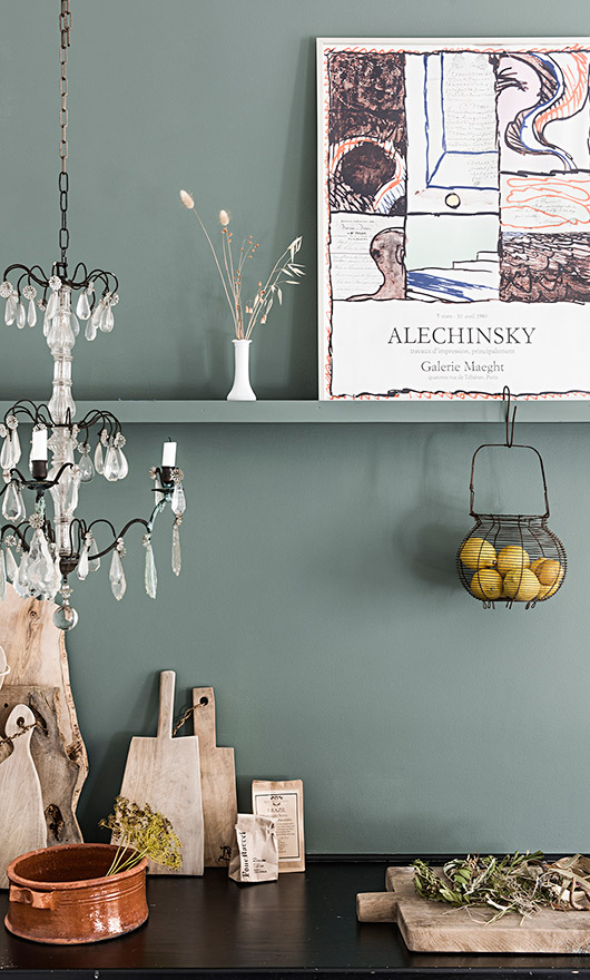 danish kitchen with gray wall and with dark counters and assorted kitchenwares displayed / sfgirlbybay